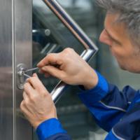 Mature Male Lockpicker Fixing Door Handle At Home